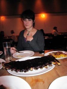 Liz wonders who ordered the vegetables as she eyes the balsamic glazed pork ribs.