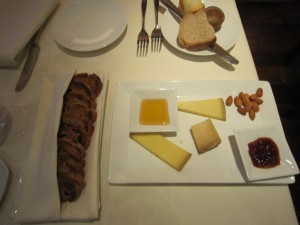 Artisan cheese plate with house made blood orange balsamic jelly and local honey