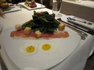 "warm ""Bautista Farms"" spinach salad, La Quercia proscuitto, quail egg and Minus 8 vinaigrette"